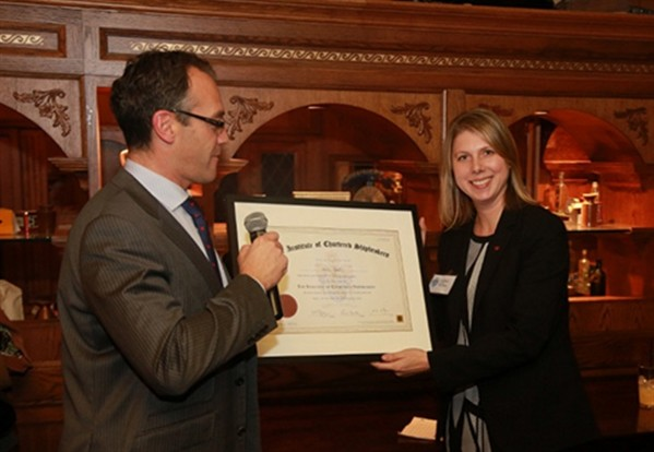 Dena Rantz FICS, of Teekay receives her Institute of Chartered Shipbrokers certificate frome Peter Amat of Pacific Basin